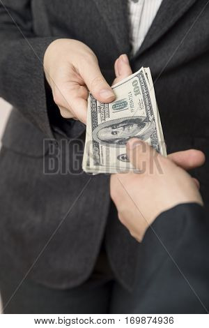 Business woman offering money for bribe. Selective focus