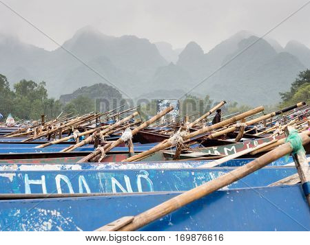 Huong Son, Vietnam - March 8, 2016: Tourist boats lined up at the warf on the way to Perfume Pagoda