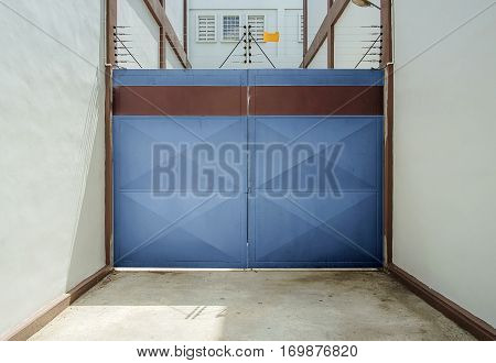 Blue door with warehouse closeup photo stock