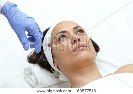 Young Woman Having Cheek Injection Treatment at Beauty Clinic