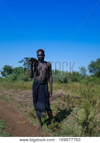 Mago, Omo valley, Ethiopia- 03 october 2012: Mursi tribe manin national dress