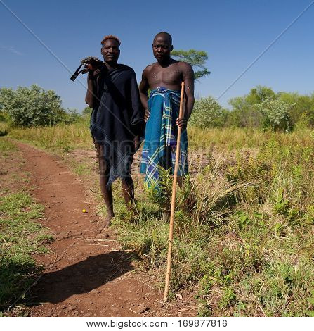 Mago, Omo valley, Ethiopia- 03 october 2012: Mursi tribe men in national dress