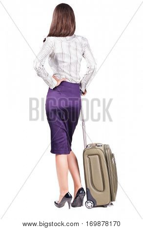 Back view stylishly dressed brunette business woman with suitcase looking up. Standing young girl. backside view of person.  Isolated over white background. languid girl in heels looks into distance
