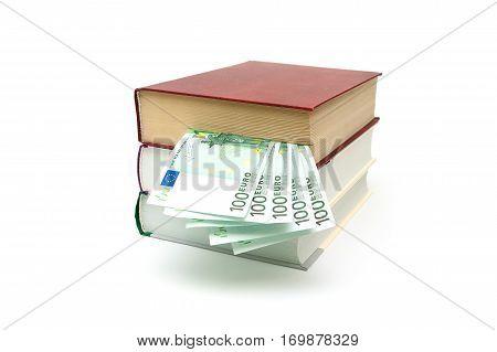 Book and money isolated on white background. horizontal photo.