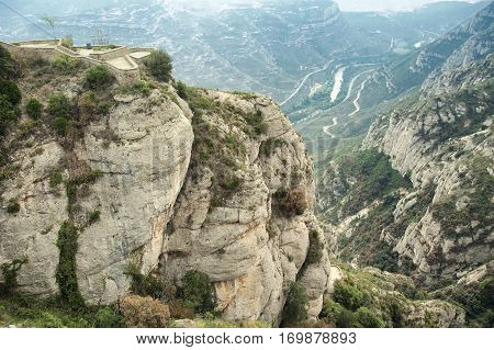 Columns of conglomerate rock stand out against the landscape at Montserrat Spain