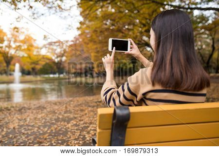 Young woman take photo of cellphone