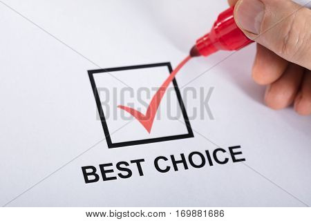 Close-up Of A Person Hand Ticking Best Choice In Check Box Option Using Red Marker