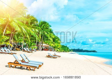 Beautiful beach. Chairs on the sandy beach near the sea. Summer holiday and vacation concept.
