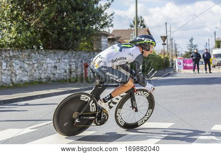 Conflans-Sainte-HonorineFrance-March 62016: The South African cyclist Jacques Janse van Rensburg of Dimension Data Team riding during the prologue stage of Paris-Nice 2016.