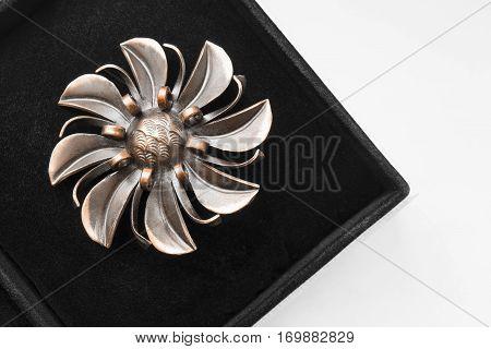 Vintage bronze flower shaped brooch in jewel box