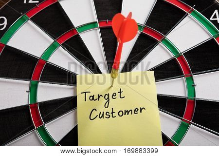 A Target Audience Concept Aimed With Arrow On Dartboard