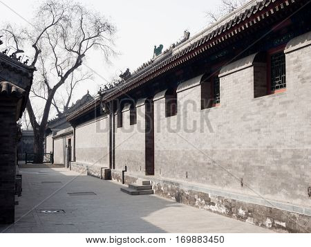 Beijing, China - March 26, 2015: Narrow alley with grey brick walls in Prince Gong palace of Beijing