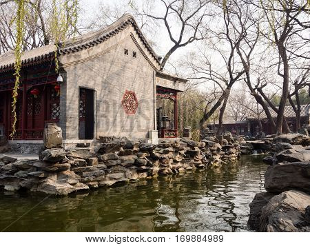 Beijing, China - March 26, 2015: Classical Chinese garden with pond in Prince Gong palace of Beijing