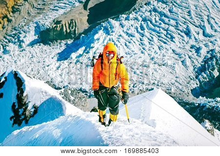A lonely climber reaching the summit. Extreme sport concept