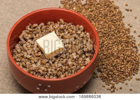 Buckwheat In A Red Bowl. Healthy Food. Buckwheat Porridge And Butter