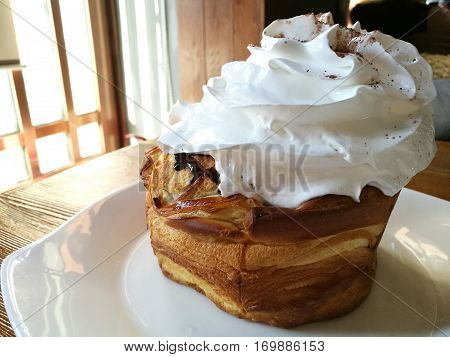 bake tost top with whipped cream and hot chocolate eat with tea after meal in café