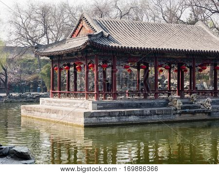 Beijing, China - March 26, 2015: Classical Chinese garden with pond and pavilion in Prince Gong palace of Beijing