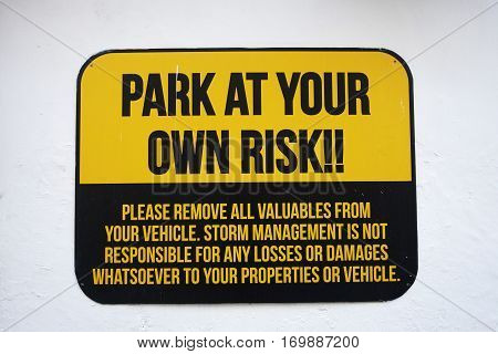 Park at your own risk sign on wall