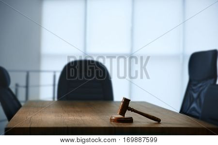 Juridical gavel on wooden table in modern office