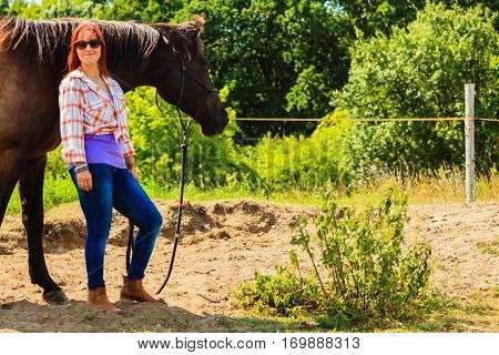 Cowgirl Standing Next To Brown Horse Friend