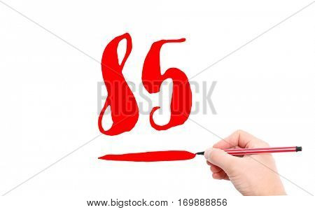 The number 85 written by a hand on a white background