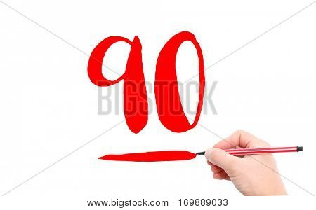The number 90 written by a hand on a white background