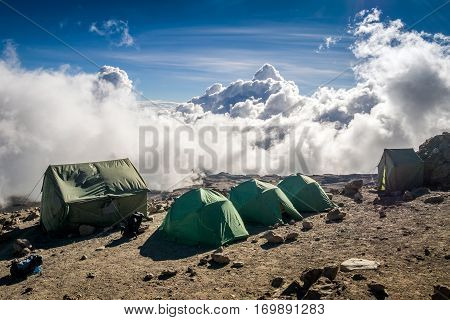 Tents Over Clouds For People Trekking Mount Kilimanjaro