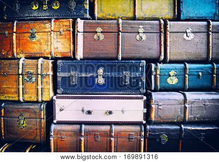 Vintage weathered leather suitcases on top of each other