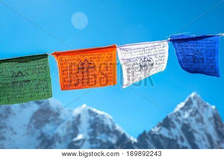 Tibetan flags with mantra on sky background Nepal
