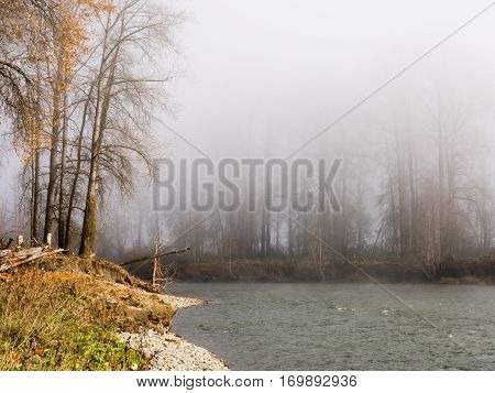 Fog over Snoqualmie river near the town of Carnation, WA, USA