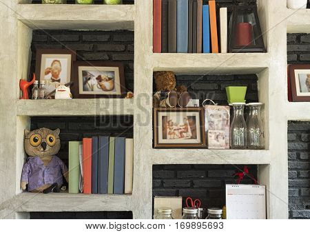 book and other concrete shelf in a coffee shop