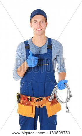 Plumber with tools on white background