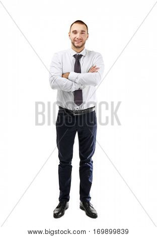Young business coach with crossed hands standing on white background