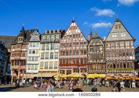 FRANKFURT, GERMANY - AUGUST 28, 2014: Summer day, people on Romerberg square in Frankfurt, Germany.