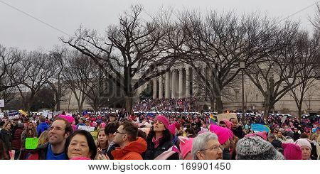WASHINGTON DC - JAN 21, 2017: Women's March on Washington, marchers in front of the National Museum of Natural History, part of the large turnout in the anti-inauguration show of solidarity.
