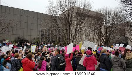WASHINGTON, DC - JANUARY 21, 2017: Protesters hold up anti-Trump signs as thousands participate in the Women's March on Washington for social justice, the day after the Presidential Inauguration.
