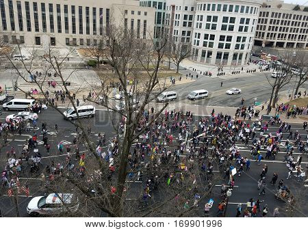 WASHINGTON DC - JANUARY 21, 2017: High angle view of thousands of protesters participating in the Women's March on Washington DC, on the Constitution Avenue that leads to the Capitol Building.