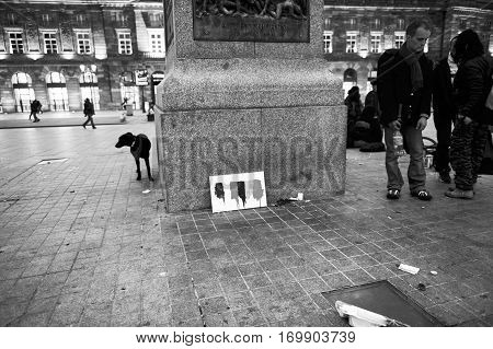 STRASBOURG FRANCE - MAR 24 2016: Black and white of people standing near the General Kleber statue after the 2016 Brussels bombings