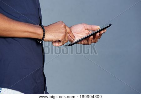 African Man Hands Holding Tablet