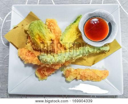 Restaurant dish of fried shrimps tempura, on white plate with soy sauce cup. Japanese fusion food, Asian cultures. Flat lay aerial view. Local Japanese food.