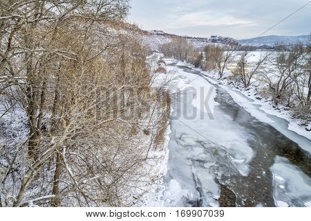 partially frozen Poudre River at Belvue Dome above Fort Collins, Colorado - aerial view of winter scenery