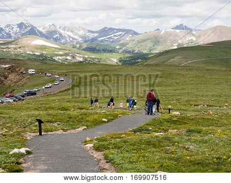 Rocky Mountain National Park USA - July 14 2015: Visitors hiking on trail along Trail Ridge road in Rocky Mountain National Park