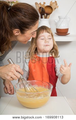 Child Likes Whipped Cream Next To Mother