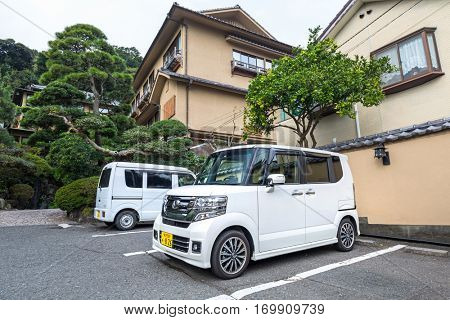 KAMAKURA, JAPAN - NOVEMBER 8, 2016: Traditional architecture of Kamakura with japanese cars on the street in Japan. Kamakura is a city in Kanagawa Prefecture, about 50 kilometres south-west of Tokyo.