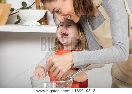 Woman And Child Cooking And Laughing