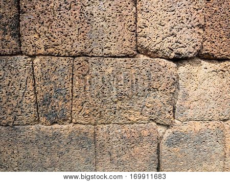 Close up of old laterite stone wall background