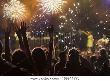cheering crowd and fireworks - New Year concept