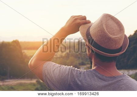 Man looking mountain or male peaceable with sunshine in the morning and mountain view.