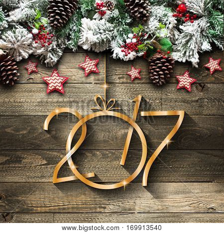 2017 New Year  Frame with green pine, colorful baubles, knots with berries,stars and other seasonal stuff over an old wooden aged background