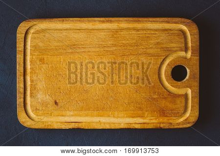 Old Cutting Board On A Dark Background. Top View